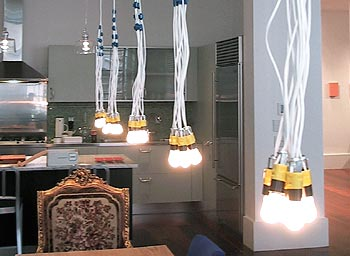 Gnr8 news hg light a miniature and at 75 affordable version of rodi graumans 85 lamps chandelier for droog design one adjustable cord supports a cluster of six aloadofball Choice Image